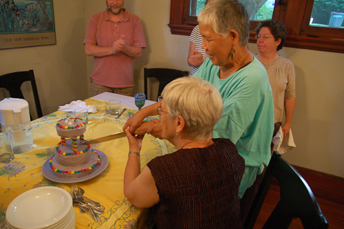 Mom and Fumiko cutting the wedding cake