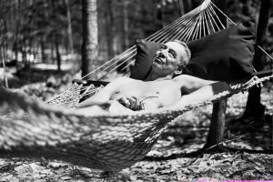 Dad, naked, in a hammock