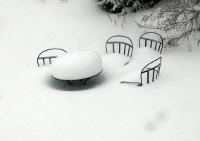 Blizzard burying chairs
