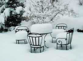 Snow on table and chairs