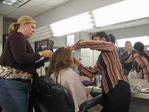 The hair and makeup women working on Susan